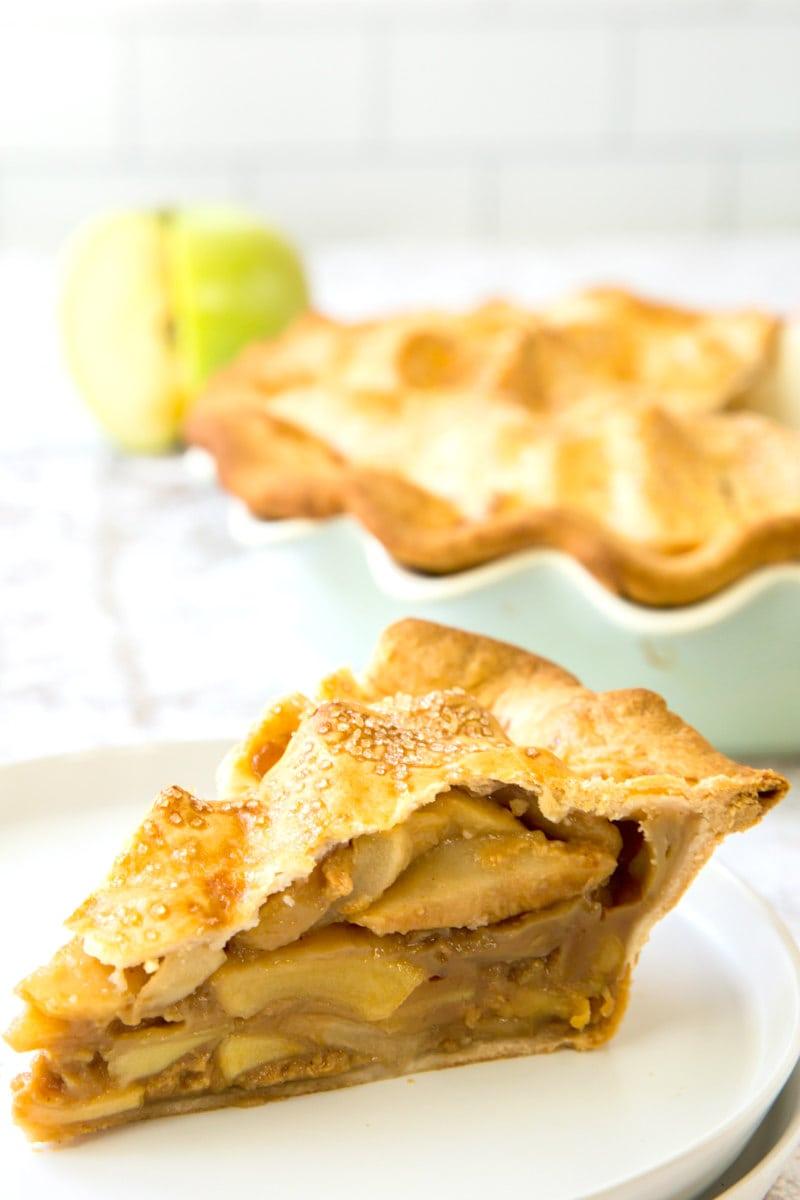 slice of dulce de leche apple pie on white plate