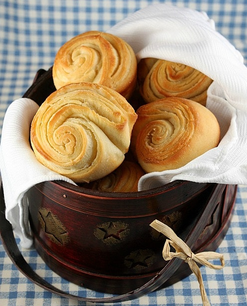 puff pastry buns in a serving container