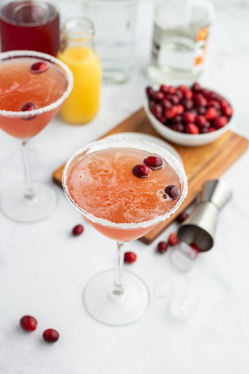cranberry margaritas in glasses with cranberries floating
