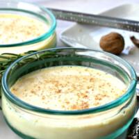 eggnog custard with nutmeg in glass dish