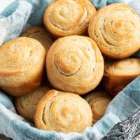 flaky dinner rolls in a basket