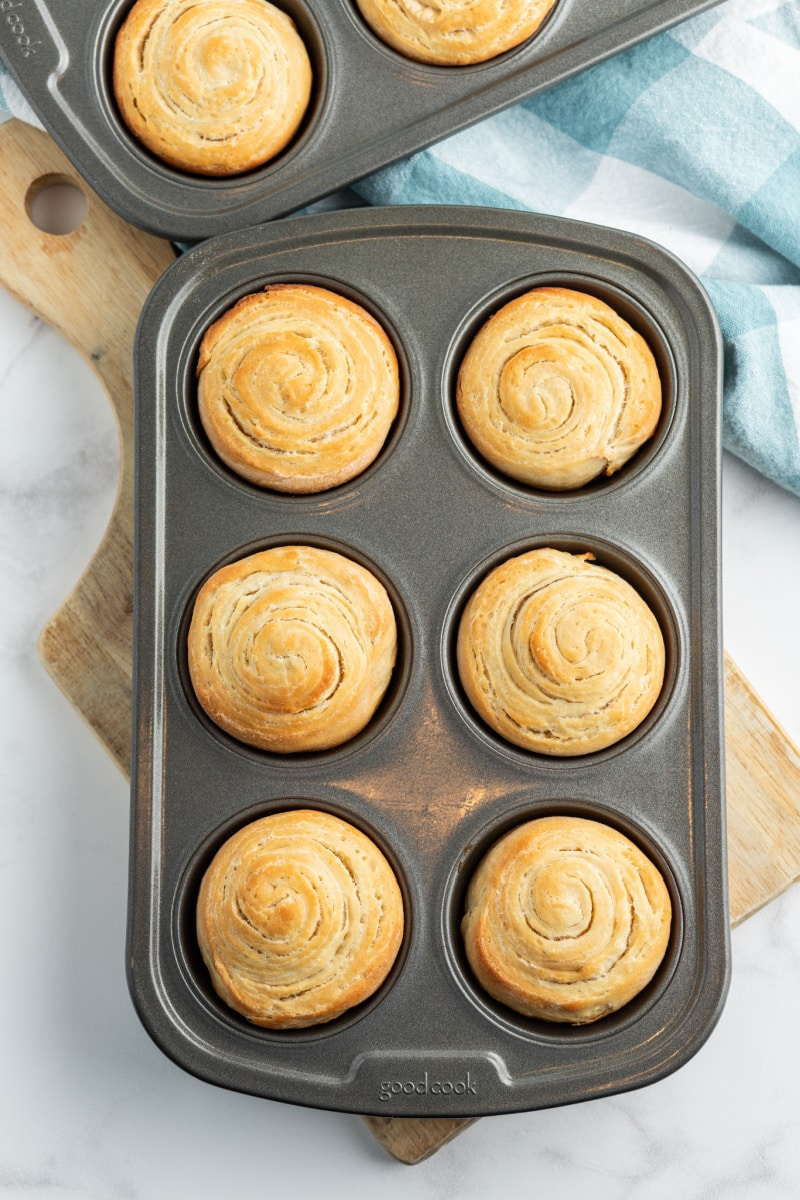 puff pastry buns in a muffin tin