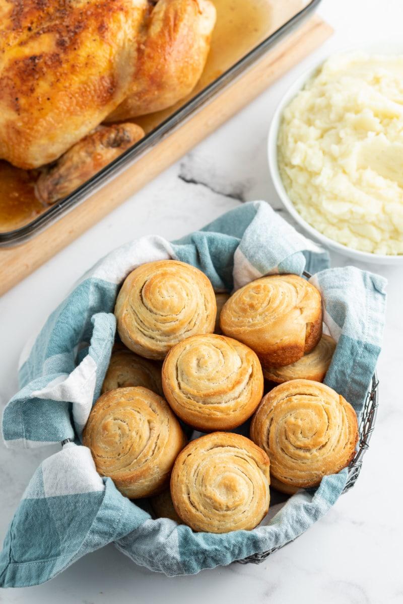 flaky dinner rolls in basket