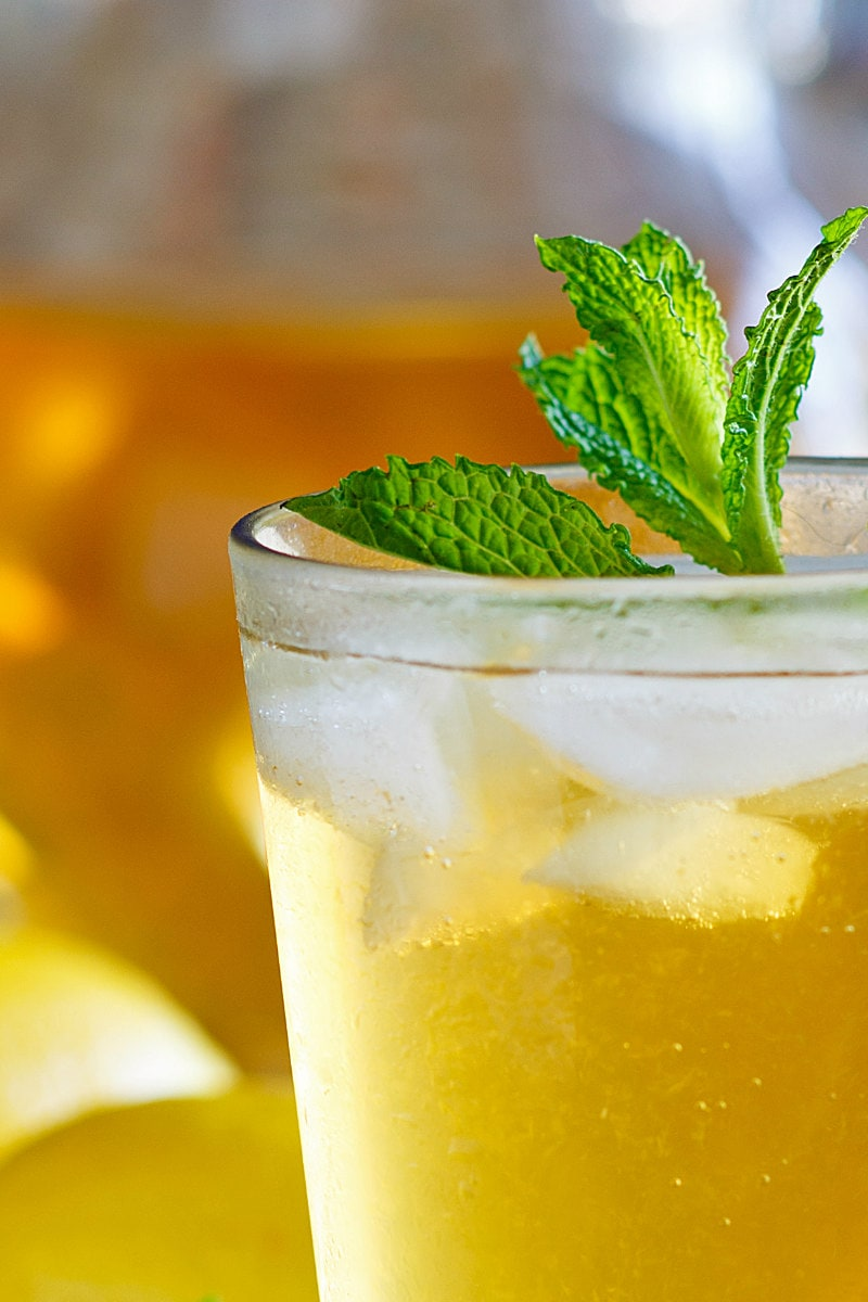 sweet summer iced tea garnished with fresh mint