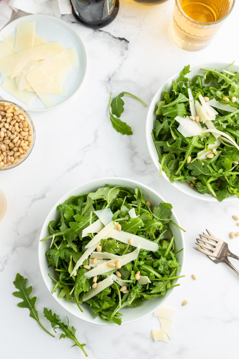 salad in two white bowls