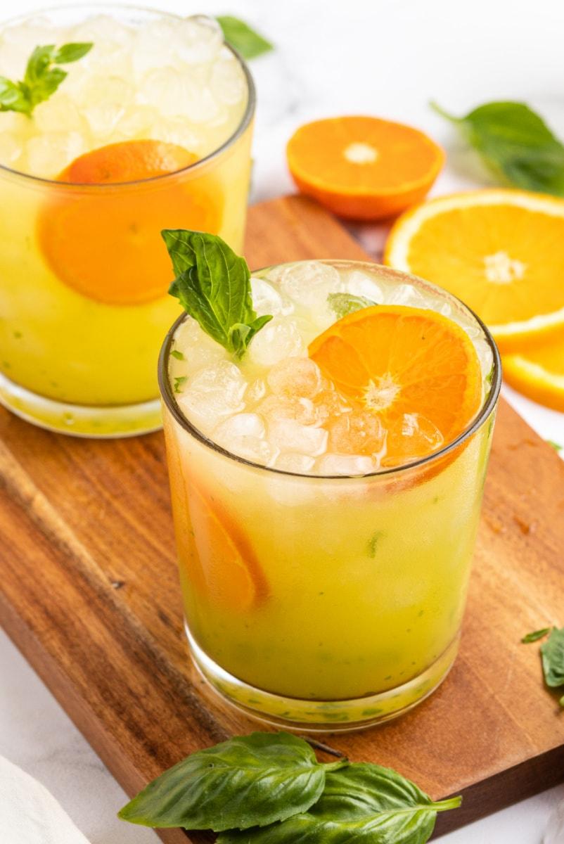 orange basil mojitos in two glasses