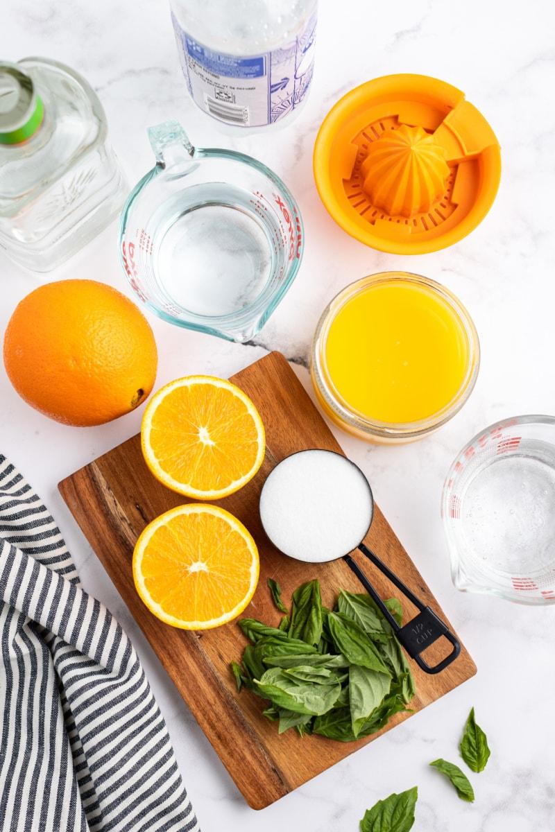 ingredients displayed for orange basil mojitos