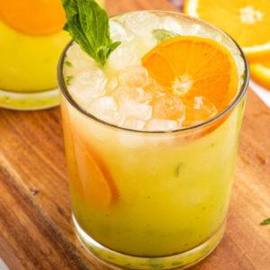 pinterest image for orange basil mojitos