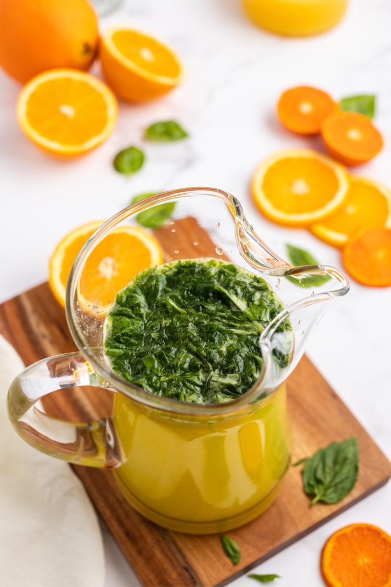 pitcher of orange basil mojitos