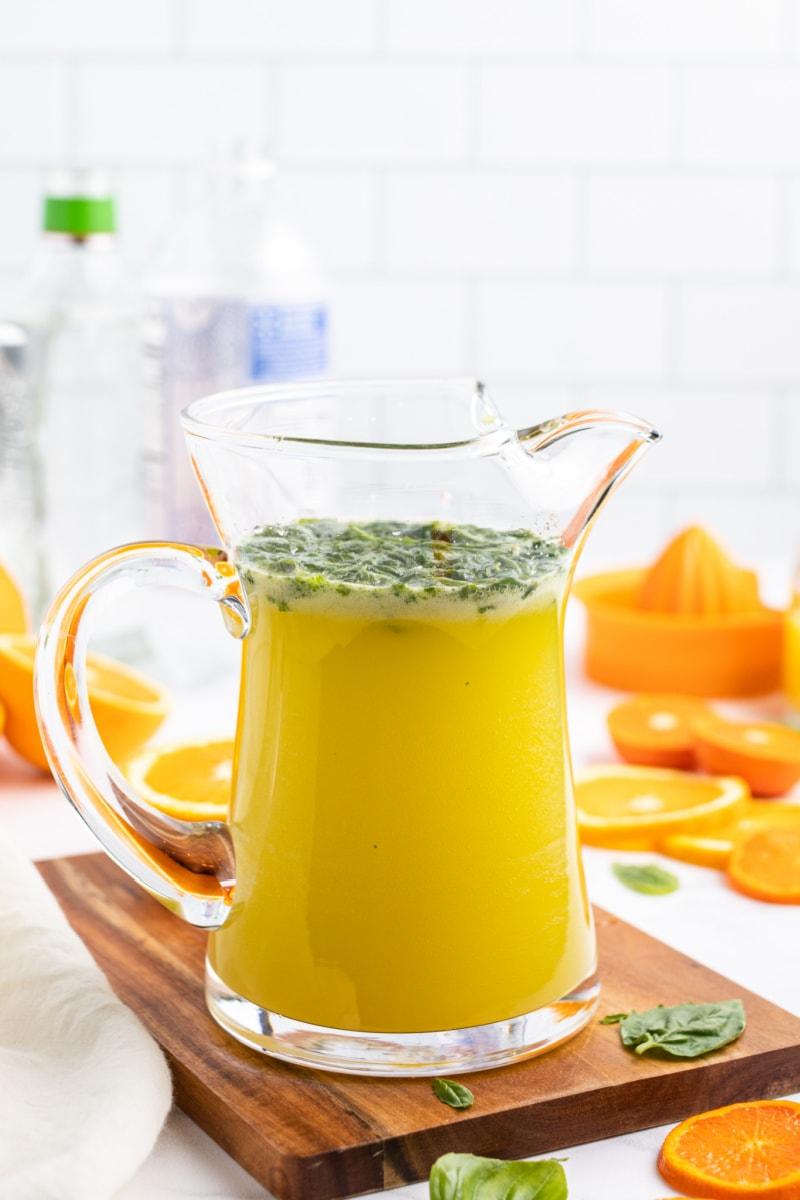 pitcher of orange mojitos
