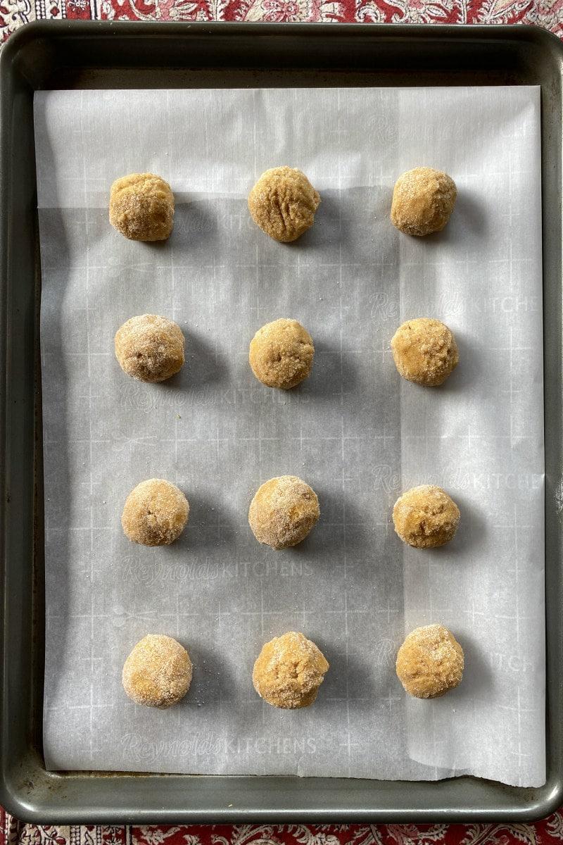 pumpkin snickerdoodle cookie dough balls on baking sheet