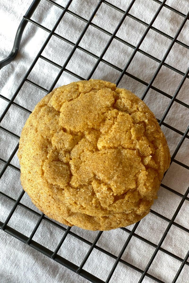 pumpkin snickerdoodle cookie on cooling rack