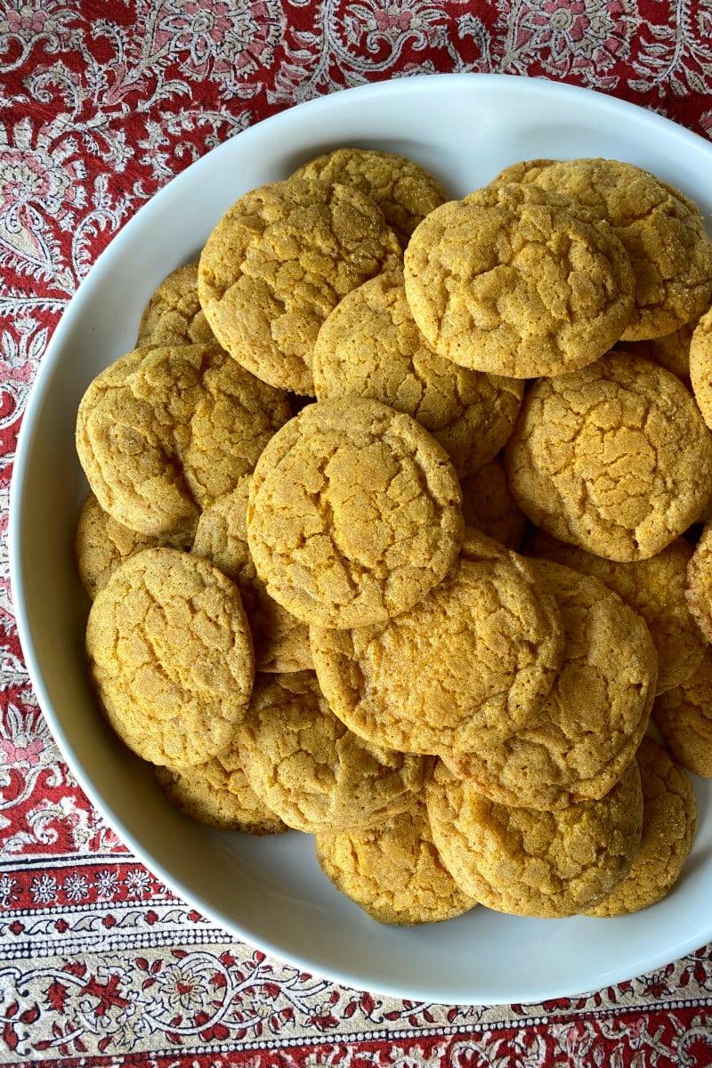 pumpkin snickerdoodle cookies piles on white platter