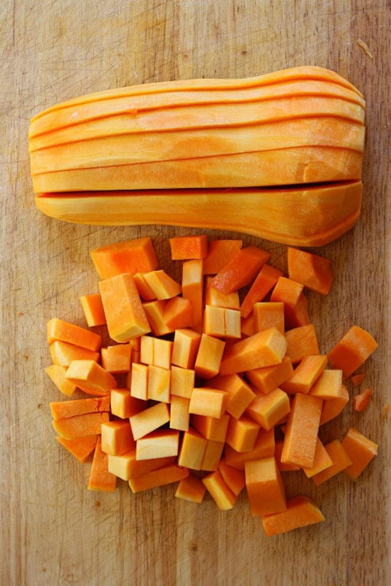 chopping butternut squash on cutting board