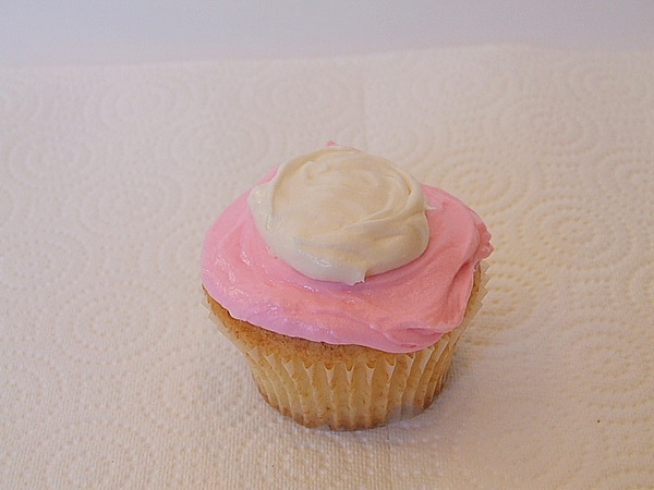 pink and white frosted cupcake