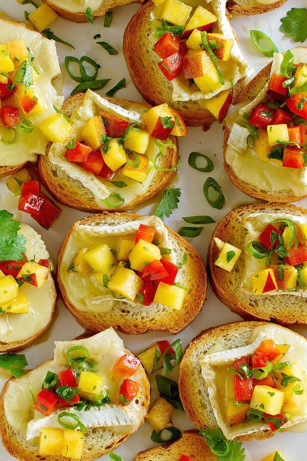 overhead shot of peach and brie bruschetta displayed on a serving platter