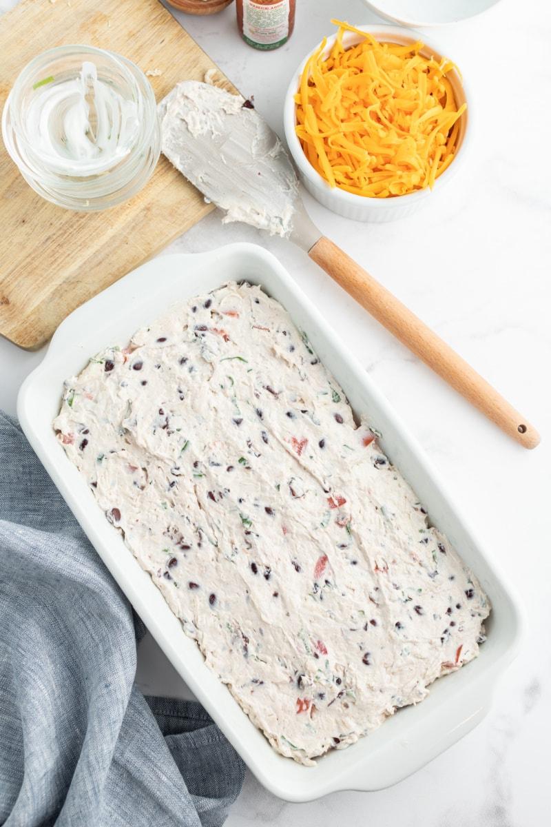 creamy cheese layer spread into dish for dip recipe