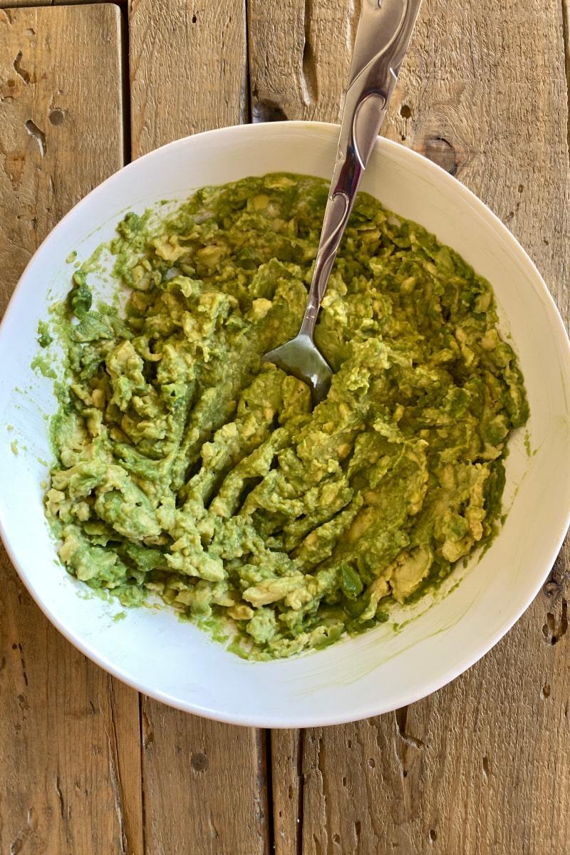 mashed avocado in white bowl
