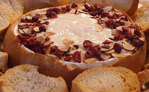 Baked Brie with sliced almonds and cranberries