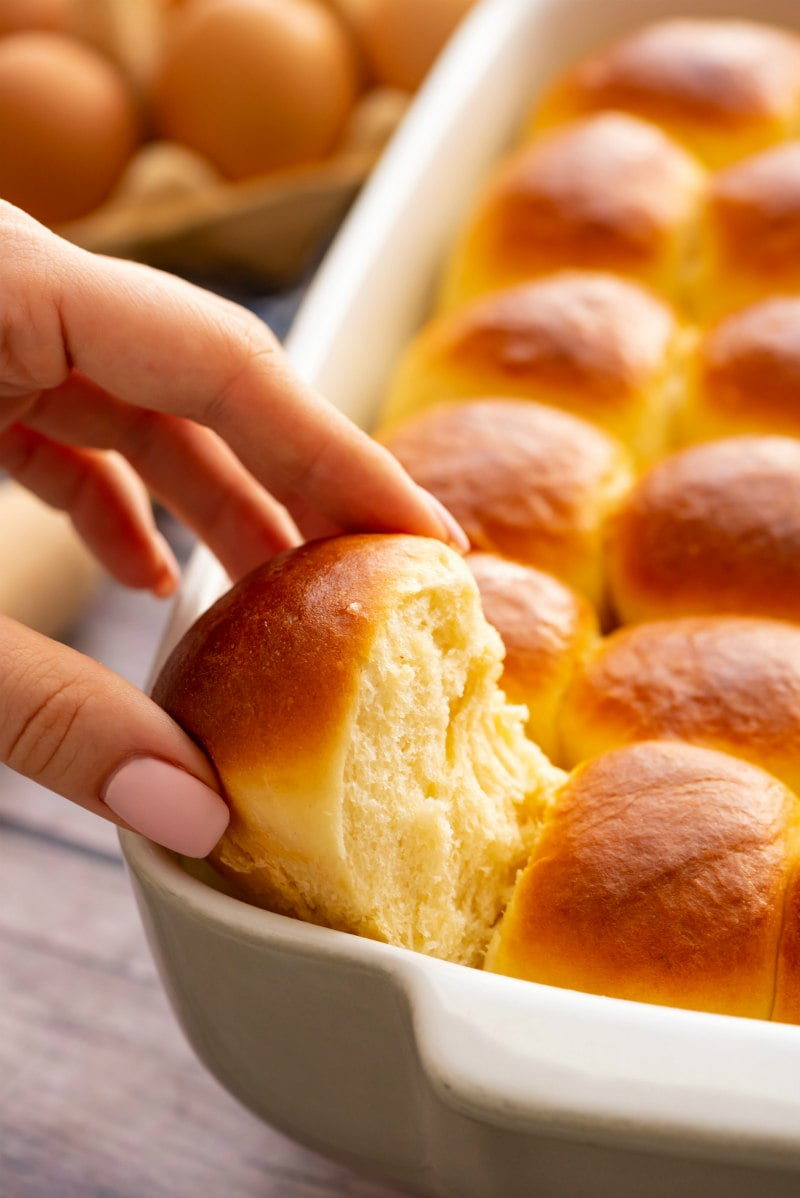 pulling Easy Dinner Rolls out of the pan