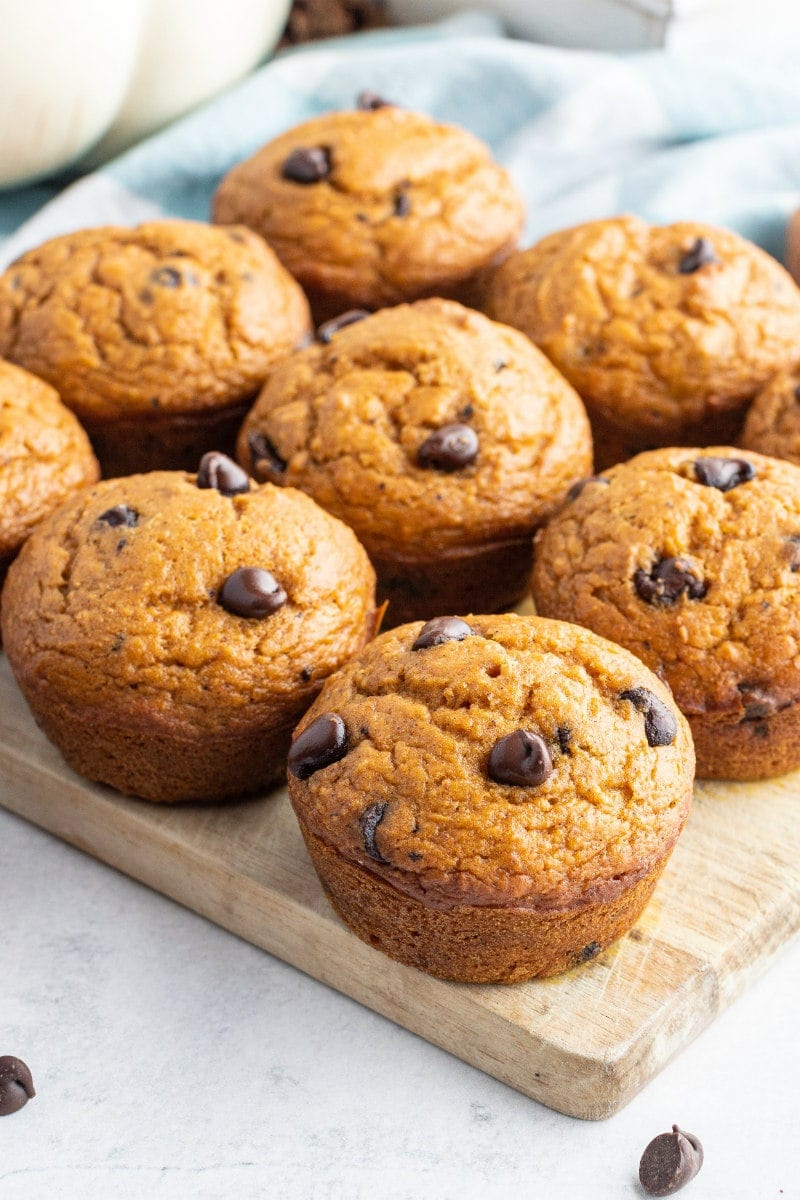 pumpkin chocolate chip muffins on a cutting board