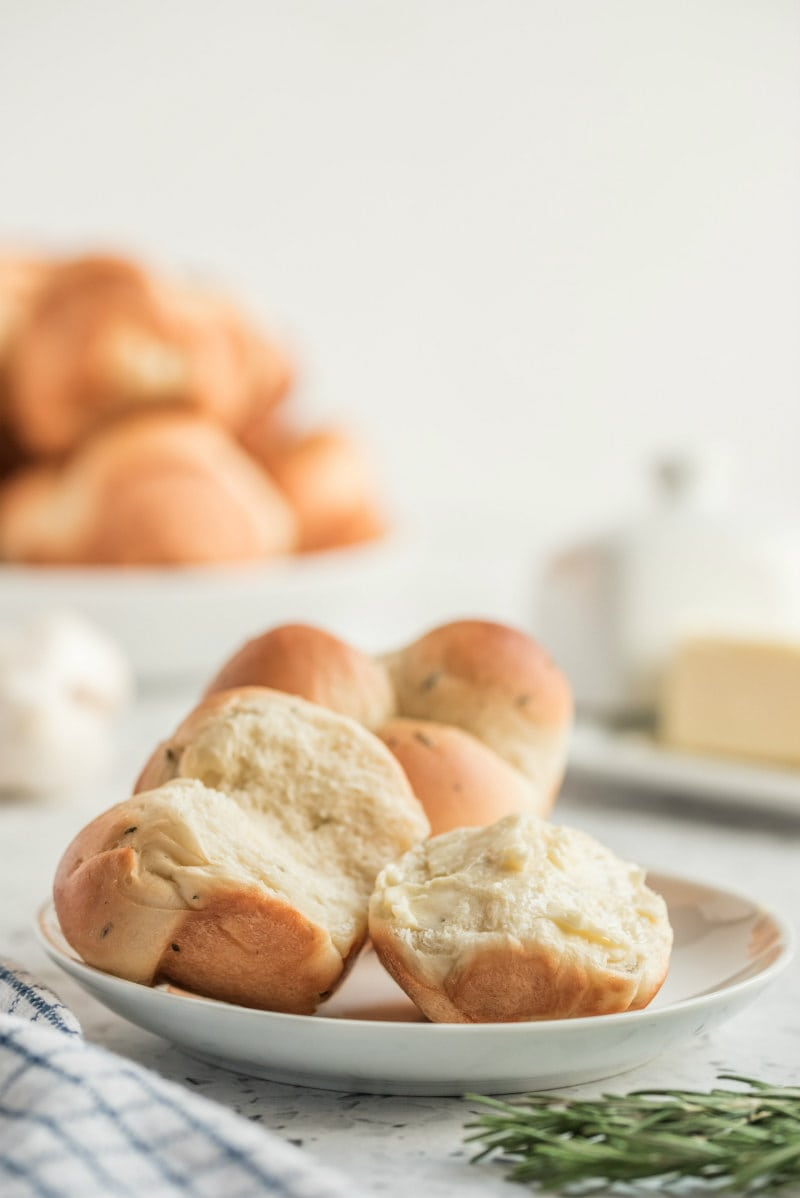 cloverleaf rolls on a white plate pulled apart