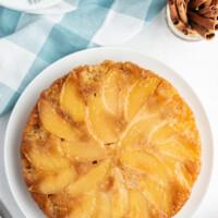 apple cinnamon upside down cake on white plate