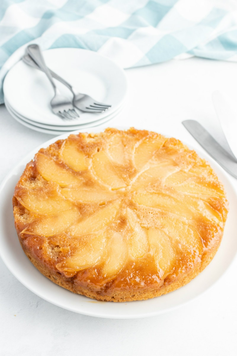 apple upside down cake on white platter