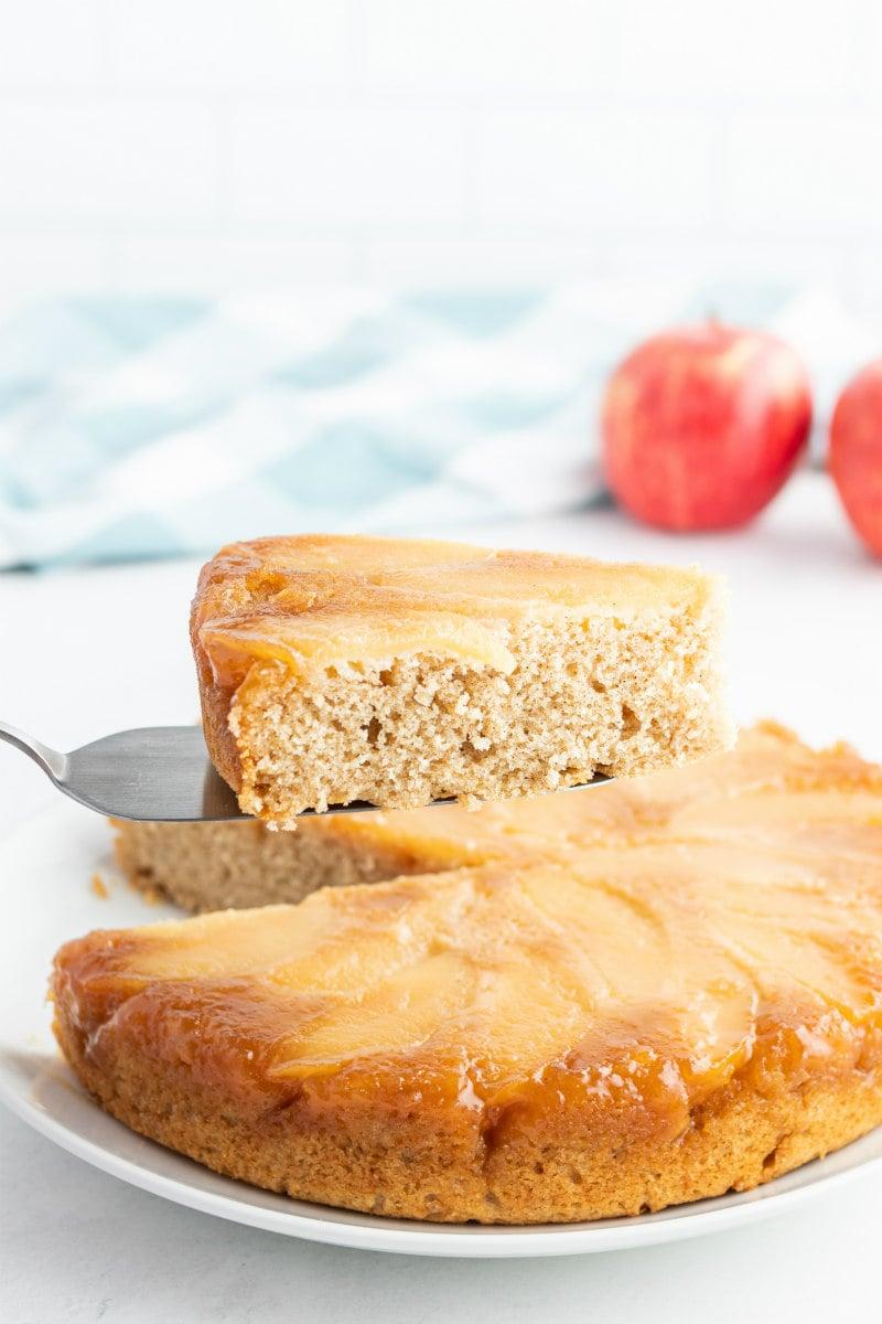 serving slices of upside down apple cake