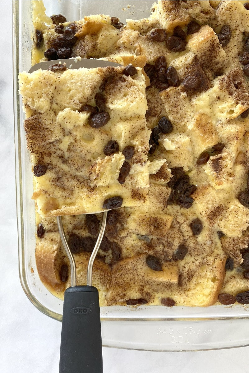 Using a spatula to serve Classic Bread Pudding