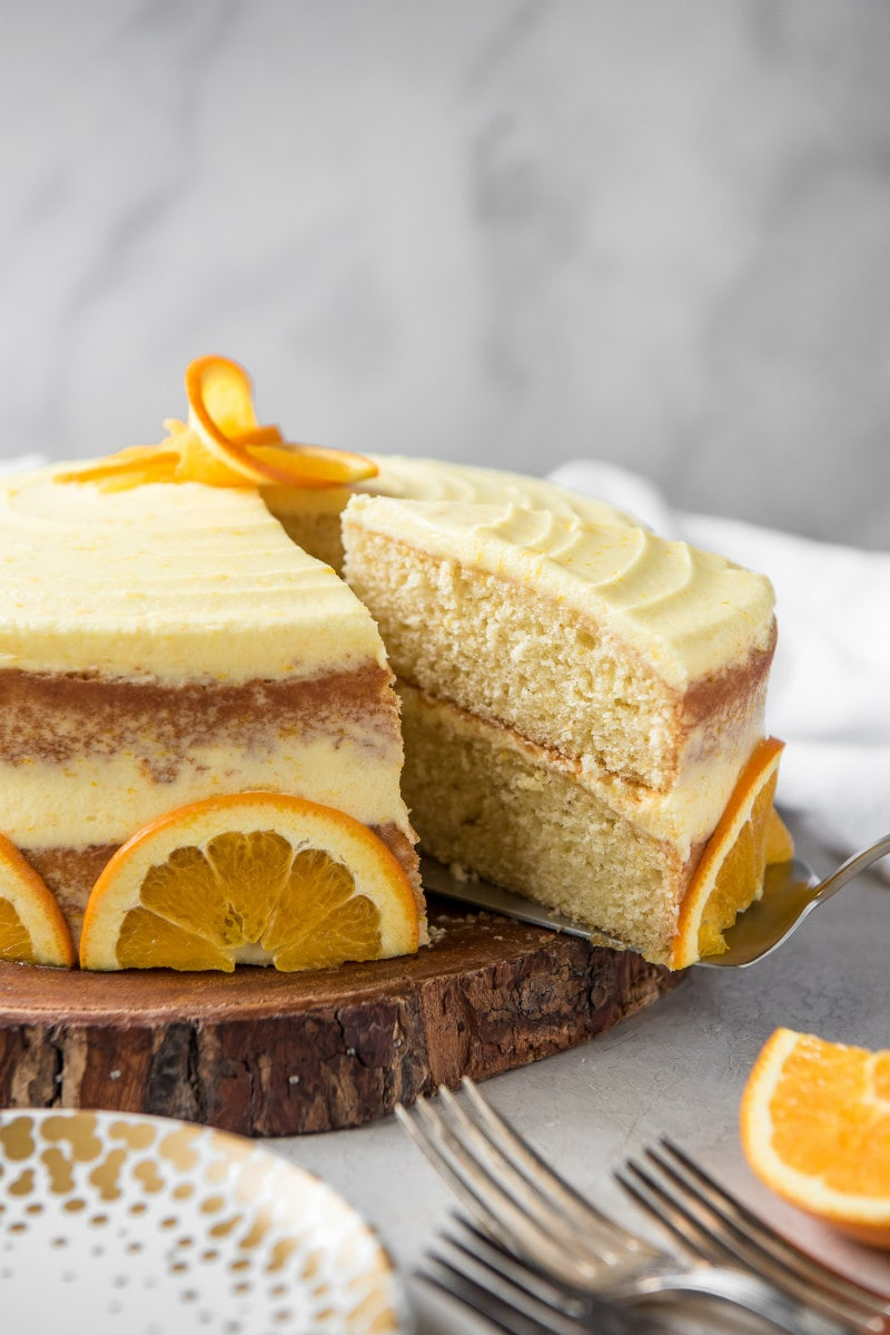 serving fresh orange layer cake