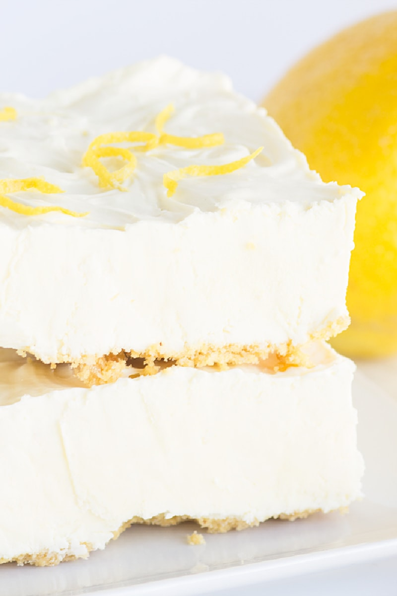 two frozen lemon cheesecake squares stacked