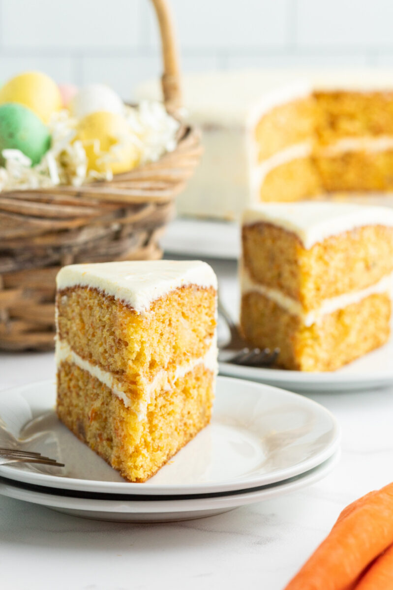 slices of carrot cake on plates with easter basket in background
