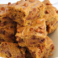 cinnamon pumpkin bars stacked on a white plate