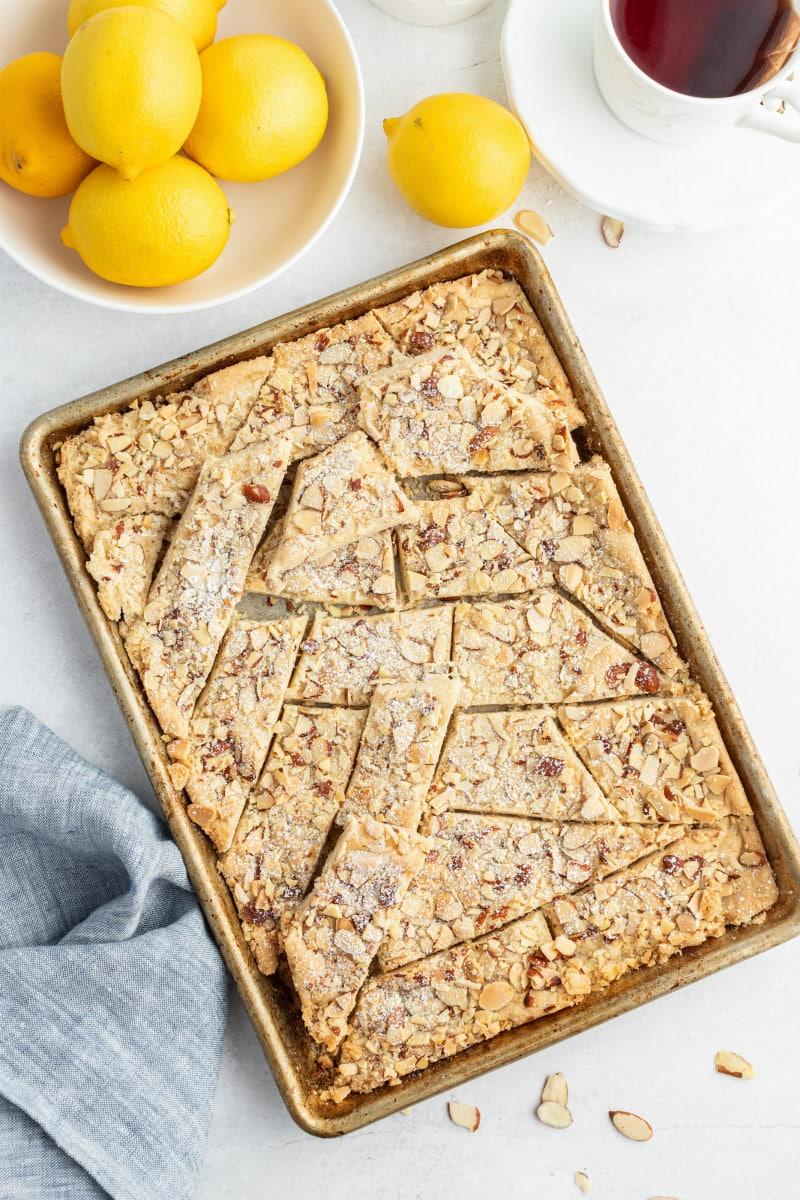 pan of lemon almond cookie brittle broken apart