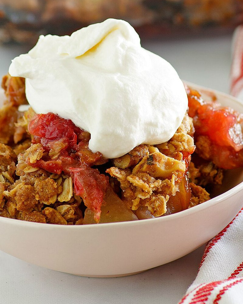 Bowl of Apple Cranberry Crisp with Maple Whipped Cream