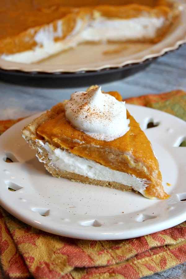 Slice of No Bake Double Layer Pumpkin Pie on a white plate