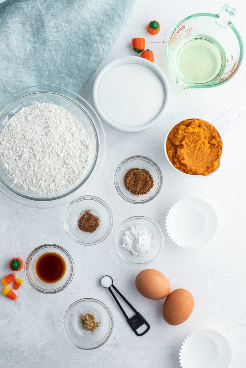 ingredients for pumpkin cupcakes displayed in bowls