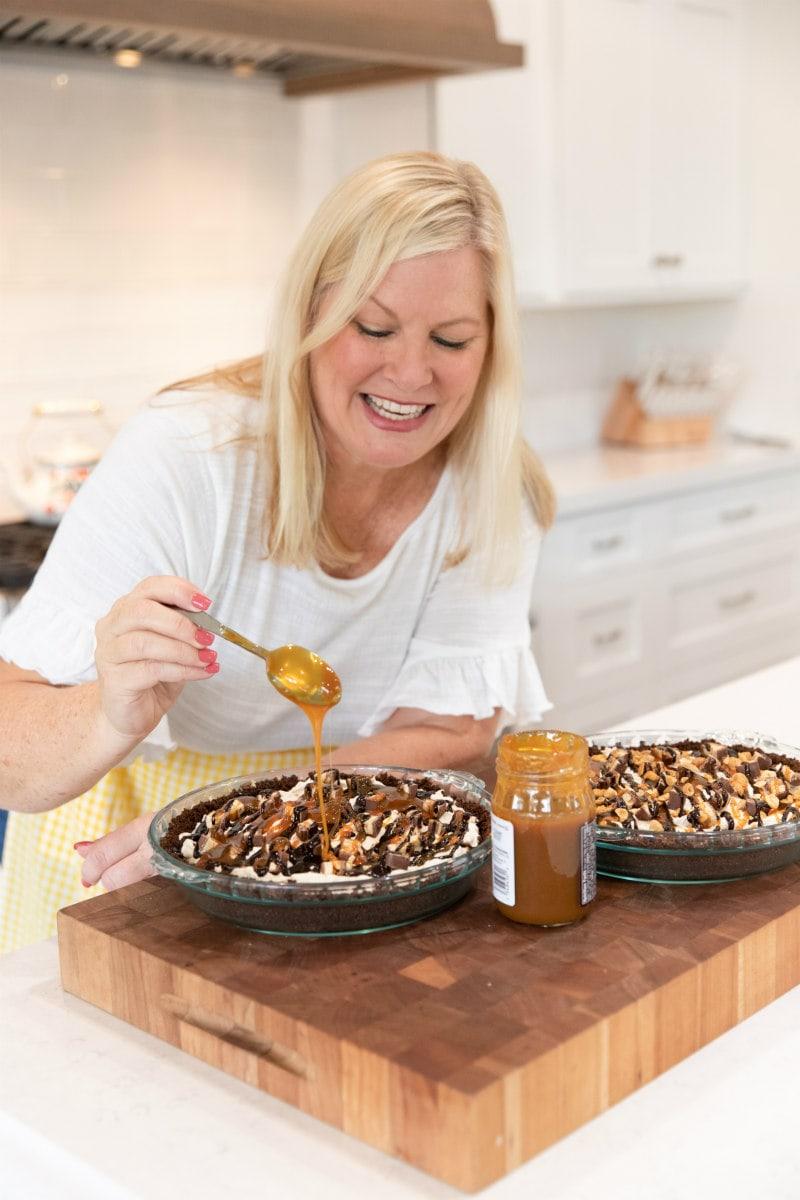 RecipeGirl adding caramel to pie