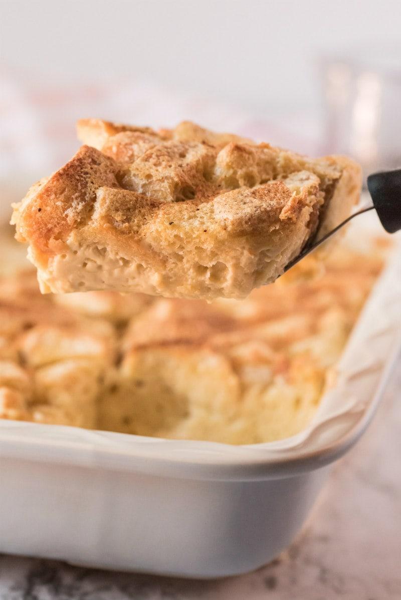 spatula serving slice of bread pudding