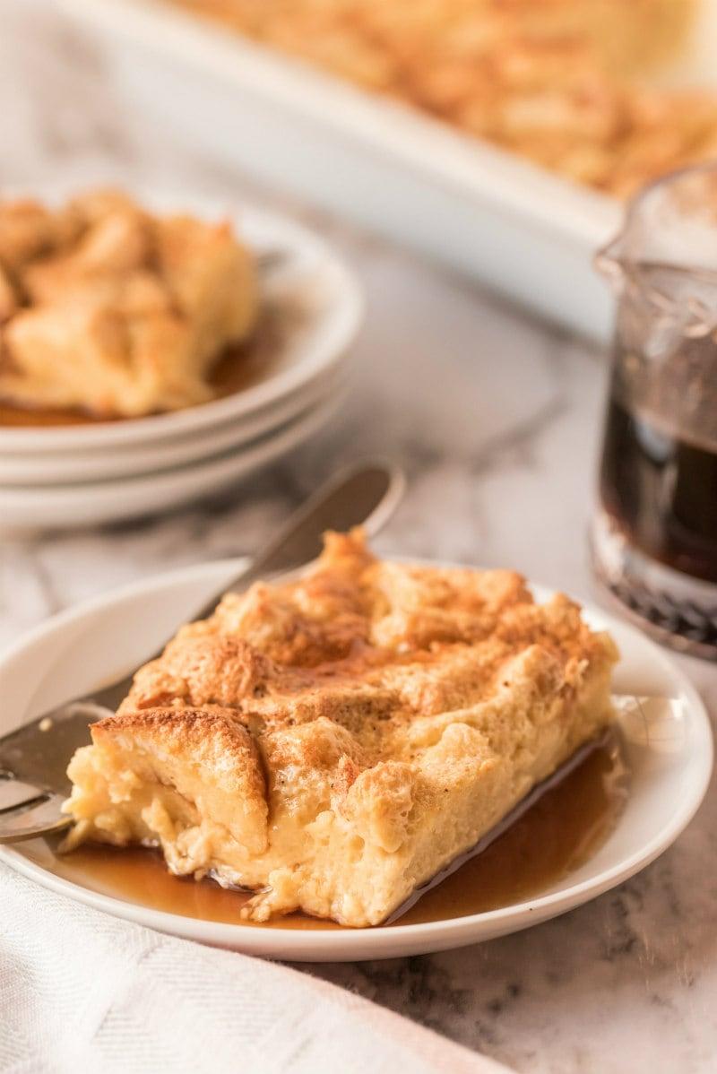 slice of maple custard bread pudding on white plate