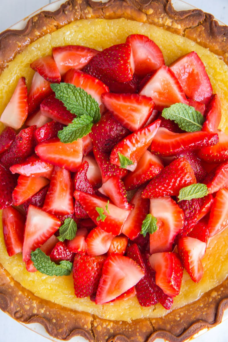 Overhead shot of Strawberry Lemon Buttermilk Pie garnished with fresh mint