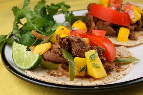 Beef Fajitas topped with Mango Salsa