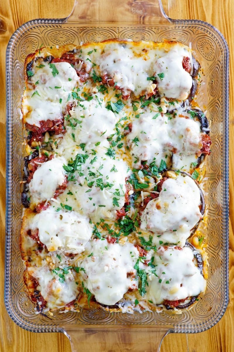 Beef and Eggplant Casserole Recipe - This Beef and Eggplant Casserole is tomato based and has plenty of added cheese.  Cinnamon and pine nuts are added in to create some unique flavors. #beef #eggplant #casserole #maindish #dinnerrecipe