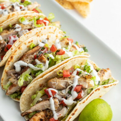 beer marinated chicken tacos on white platter