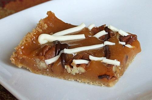Caramel Pecan Bars with Chocolate Drizzle recipe from RecipeGirl.com