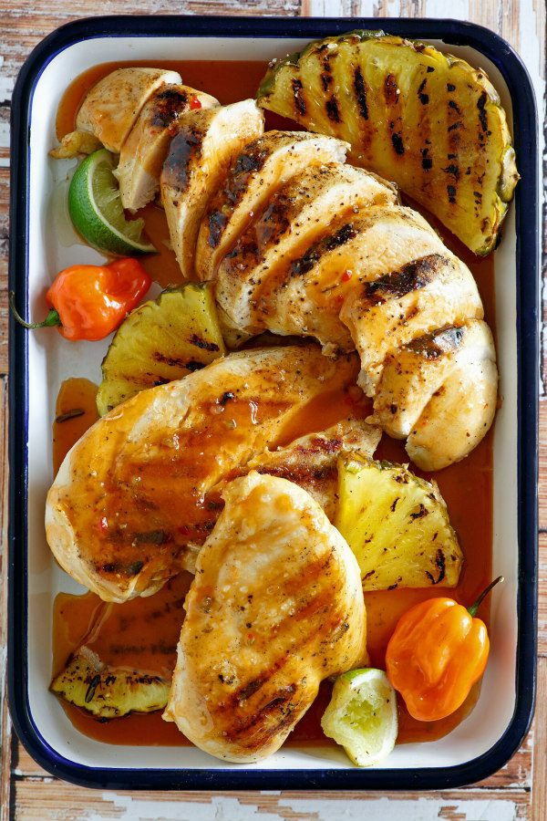 Chicken in a roasting pan with pineapple and tequila