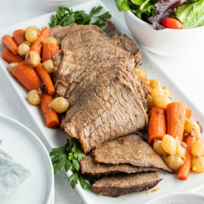 cranberry roast beef on a platter with vegetables