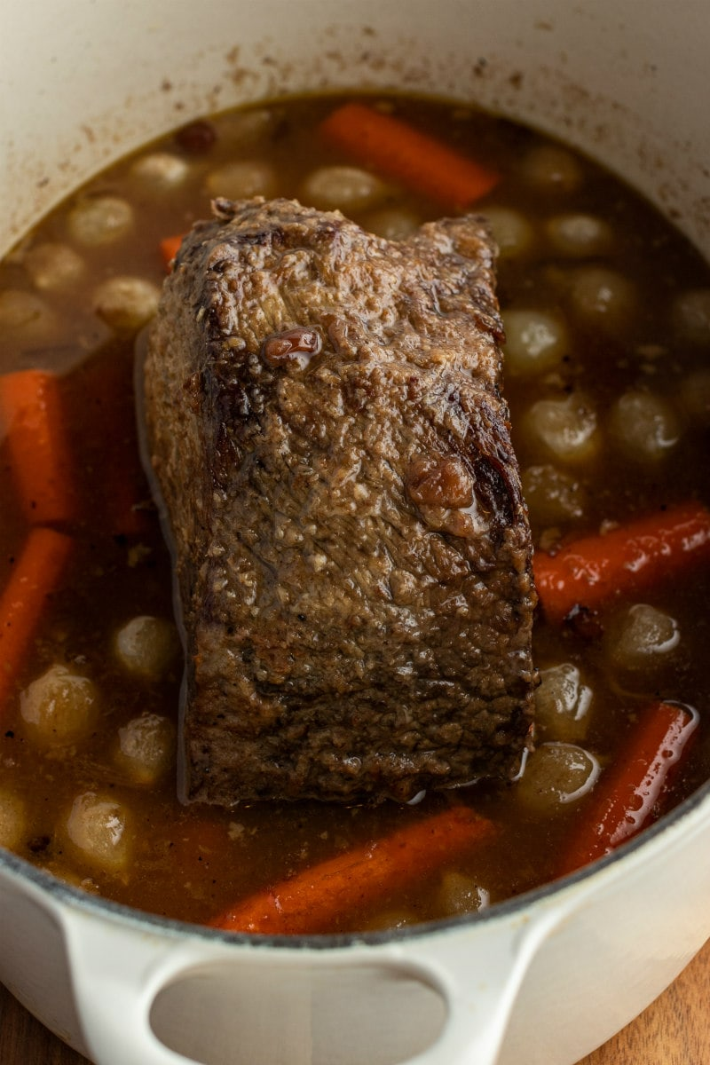 cranberry roast beef in pot with carrots and onions