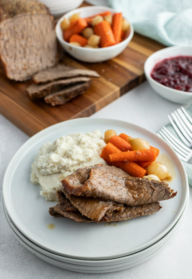 plated roast beef slices with carrots
